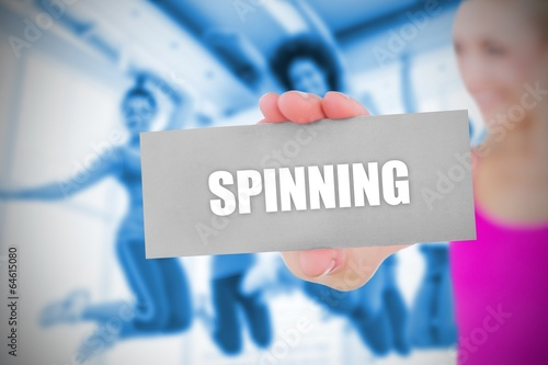 Fit blonde holding card saying spinning