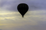 Fototapeta Fototapeta z niebem - Hot Air balloon flying over the clouds