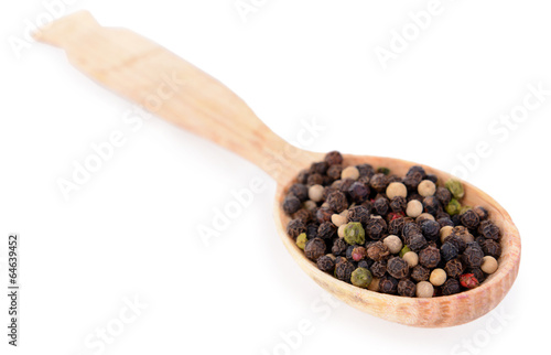 Spice pepper in wooden spoon isolated on white