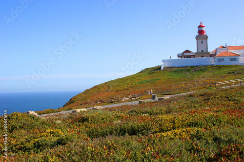 Foto auf AluDibond Beacon on the picturesque rock by the sea
