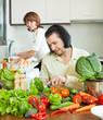couple cooking with vegetables