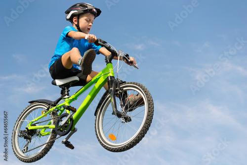 Boy jumping on bike