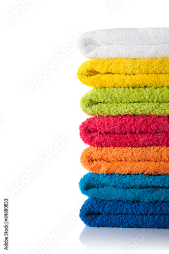 Fotografie, Obraz  Stack of colorful towels isolated on white background
