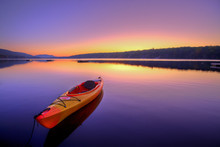 Kayak On Lake At Sunrise