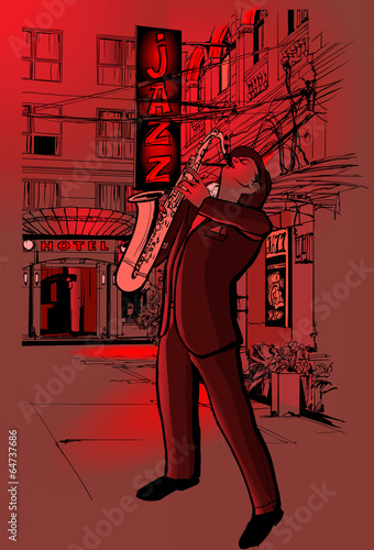 saxophone player in a street at night