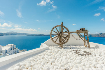 Beautiful wooden old tool as a decoration on a terace in Oia