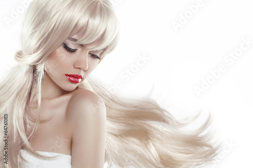 Fotografie, Obraz  Beautiful blond with long hair. Makeup. Sensual woman with blowi