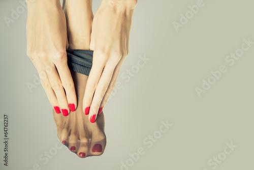 Fototapeta young female wearing black stockings