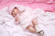 Beautiful baby girl in white