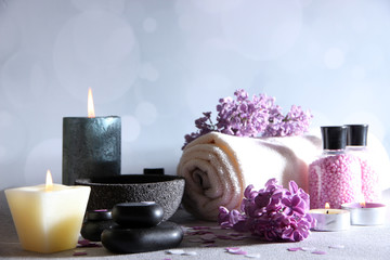 Panel SzklanyComposition with spa treatment, towels and lilac flowers,