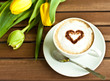 coffee cup with heart and yellow tulips