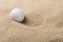 Golf Ball On The Sand