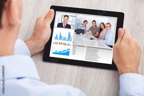 Obraz Businessman Video Conferencing With Team On Digital Tablet - fototapety do salonu