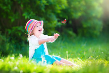 Beautiful Toddler Girl Playing With Butterfly