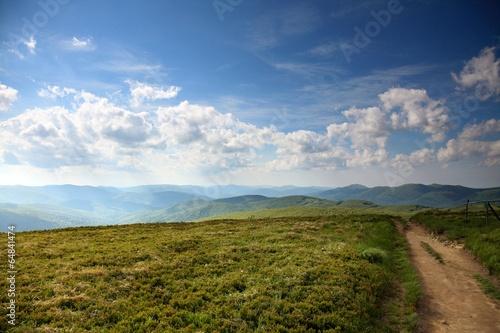 Spoed Foto op Canvas Grijze traf. Nature. Road in the mountains. Summer landscape.