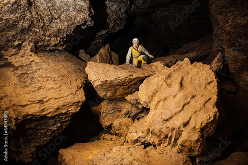 Young female caver exploring the cave