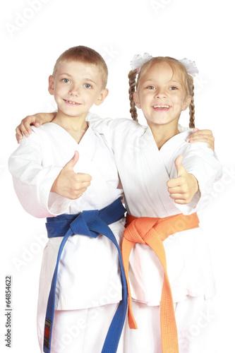 Deurstickers Vechtsport In karategi athletes show thumb super