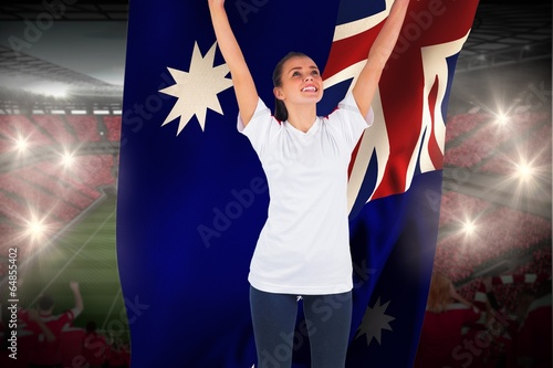 Aluminium Prints Excited football fan in white cheering holding australia flag
