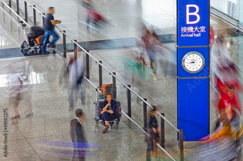 people in motion blur at the airport Poster