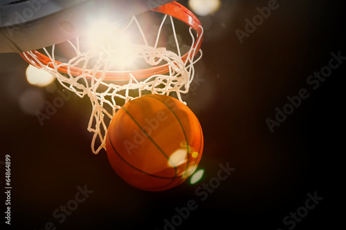 Photo  Basketball scoring basket at a sports arena