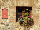 tuscan wall with window and letterbox