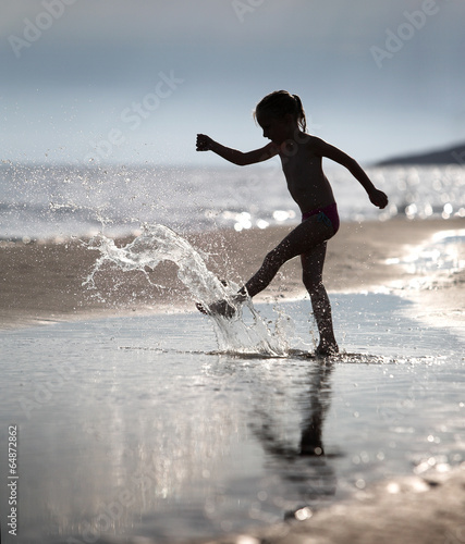 Recess Fitting Water Motor sports Young girl kicks the water at the beach holiday