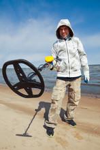 Man Using A Metal Detector