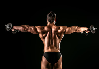 Fototapeta Do klubu fitness / siłowni back muscles