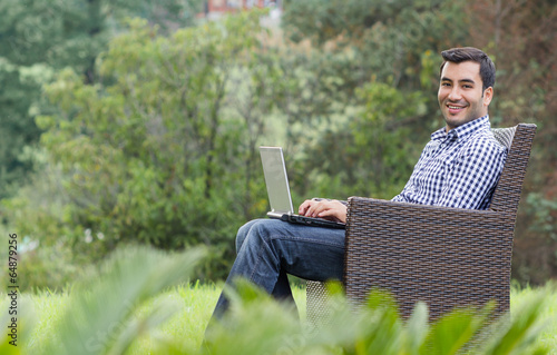 Deurstickers Smile young man with laptop, outdoor