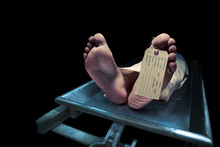 Feet On A Morgue Table With To...