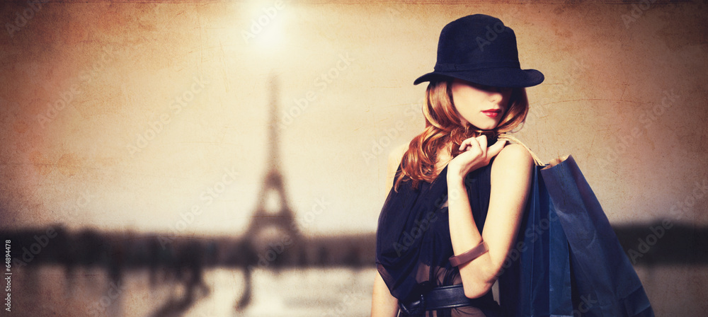Fototapety, obrazy: Redhead women with shopping bags on parisian background.
