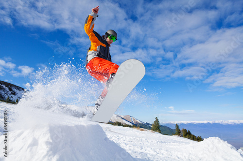 Obrazy Snowboard   jumping-snowboarder-from-hill-in-winter