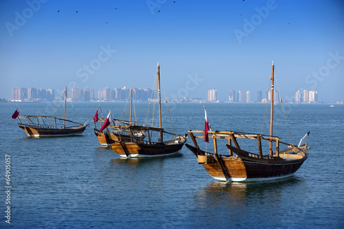 Fotografie, Obraz  Boats on a background of a modern city in doha