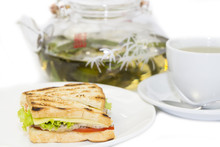 Sandwich And Tea On A White Background In The Restaurant