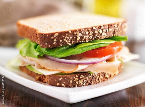 Staande foto Snack deli meat sandwich with turkey, tomato, onion, and lettuce