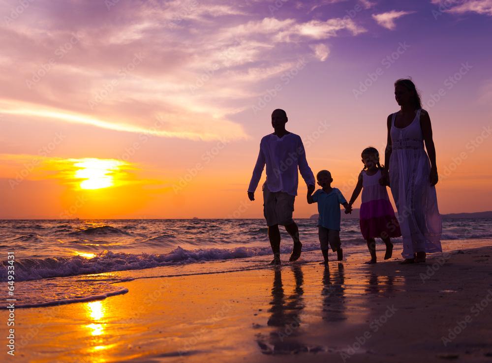 Fototapeta Family walking on the beach