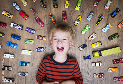 Fototapeta Boy with his toy car collection