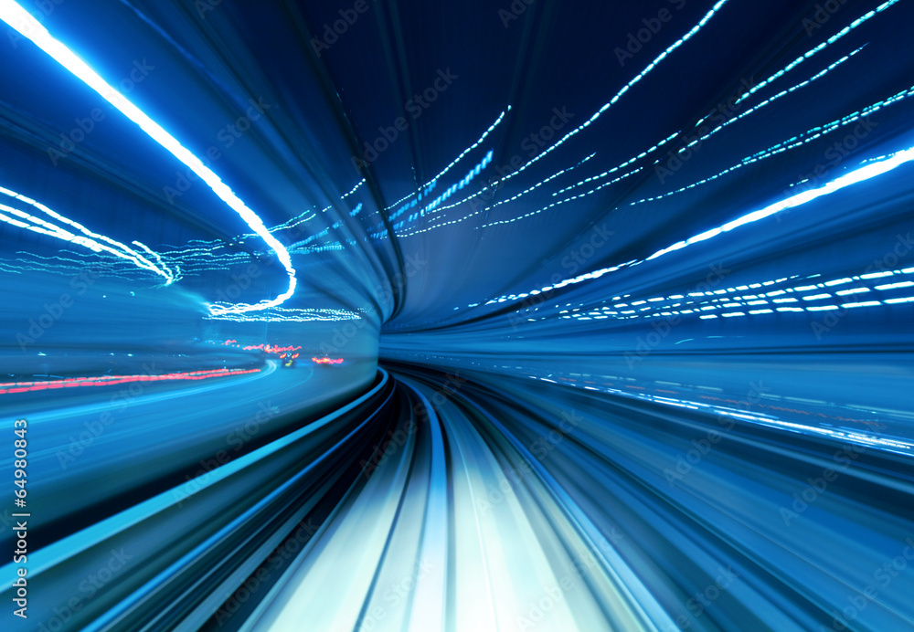 Fototapeta Train moving fast in tunnel