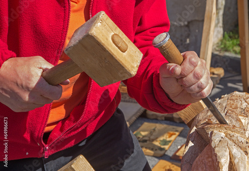 hands of carver at work Fototapeta