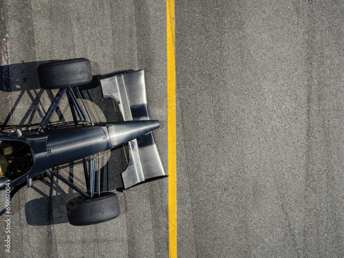 Racing Car with standing at line background