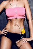 attractive fitness woman listening to music
