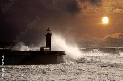Photo sur Toile Phare Stormy sunset