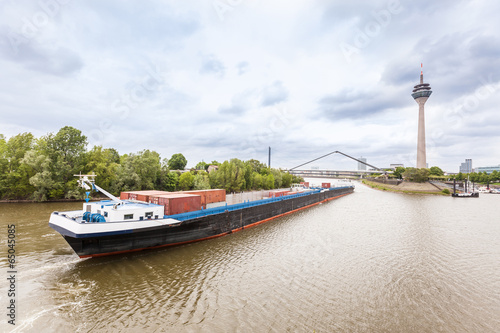 Fotografia  Cargo Barge on Rhine River in Dusseldorf