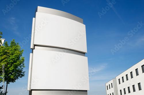 Photo  Firmenschild Stele außen umbeschriftet –Company Signboard