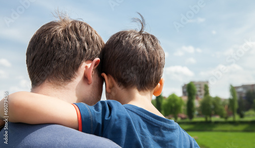 Foto  Father and son on a city background