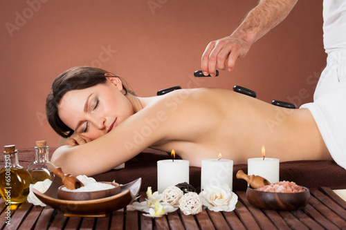 Fototapety, obrazy: Woman Receiving Hot Stone Therapy In Spa
