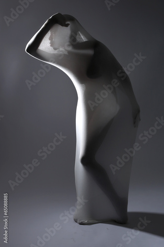 Valokuva  Shapely Woman in Creative Light and Spandex Fabric
