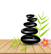 Hot stone massage on wooden table