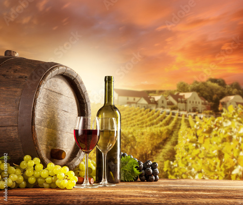 Foto op Canvas Chocoladebruin Wine still life with vineyard on backgorund