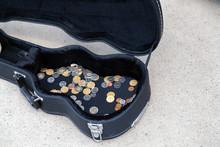 Coins In A Guitar Case In A Street